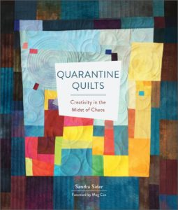 """My quilt """"Corona Virus Blues"""" is published in this book by the curator of the Texas Quilt Museum. Cover art by Anne Bellas."""